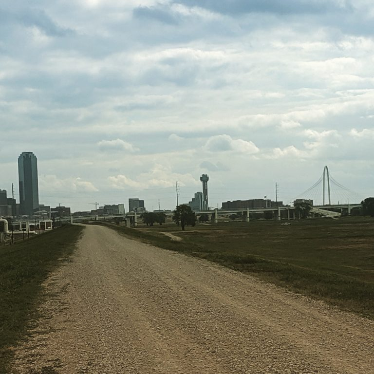 Directly adjacent to the Trinity River Levee